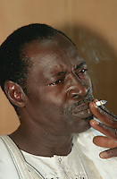Mali. Bamako. The musician Ali Farka Toure smokes a cigarette in his home  © 1997 Didier Ruef