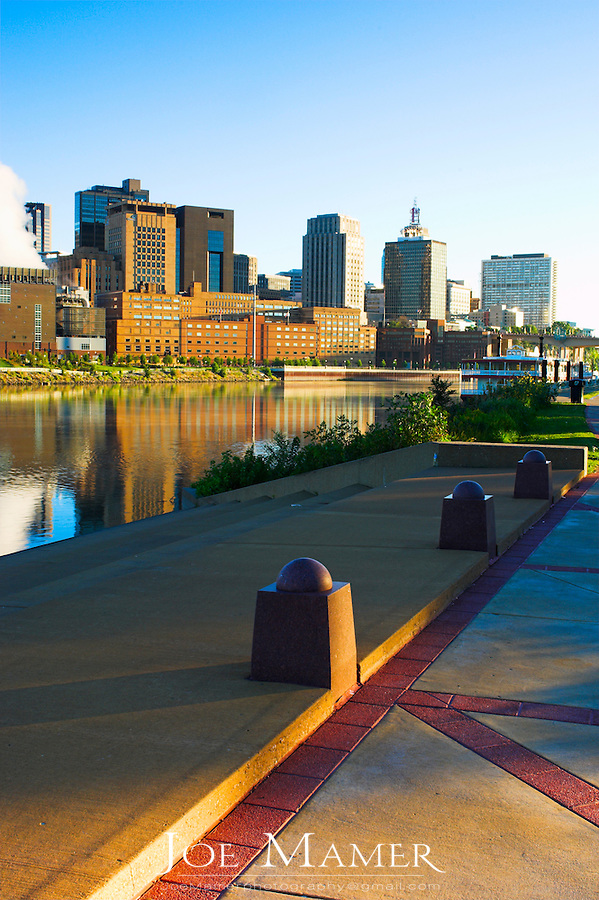 View of St. Paul, Minnesota skyline at dawn from the shore of Mississippi River.