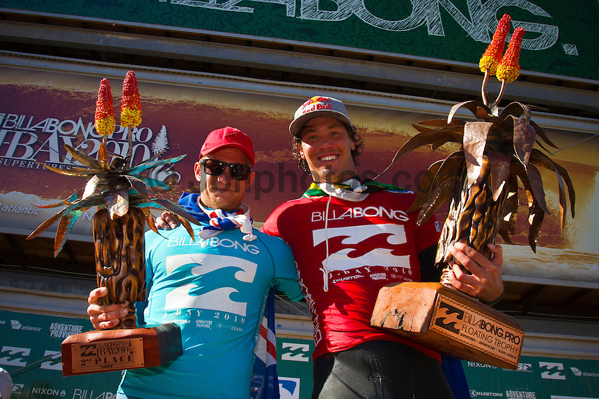 """Adam Melling (AUS) and Jordy Smith (ZAF).   JEFFREYS BAY, South Africa (Sunday, July 18, 2010) - Jordy Smith (ZAF), 22, has claimed his maiden ASP elite victory, taking out the Billabong Pro Jeffreys Bay over Adam Melling (AUS), 25, in front of a capacity hometown crowd..Event No. 4 of 10 on the 2010 ASP World Tour, the Billabong Pro Jeffreys Bay was nothing but blaring Vuvuzelas and roars from the bluff as these two titans went tit-for-tat in an incredible Final exchange. The young South African proved the victor, dominating from the outset and securing an emotional first win..""""This is the best day of my life,"""" Smith said. """"The crowd on the beach has been supporting me the last few days and hearing the cheers and the Vuvuzelas just gets me fired up to perform. It feels like they're pushing me along. I couldn't have done it without them."""".The most experienced surfer at Jeffreys Bay, Smith left very little to chance in the Final against Melling, opening his account with a blazing 8.90 before backing it up with some scintillating forehand surfing for a 9.03. The combination of scores (17.93 out of a possible 20) proved insurmountable for Melling.  Photo: joliphotos.com"""