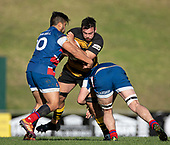 David O'Connell gets tackled by Jonathan Taumateine and Christian Kelleher. Counties Manukau Premier 1 McNamara Cup Final between Ardmore Marist and Bombay, played at Navigation Homes Stadium on Saturday July 20th 2019.<br />  Bombay won the McNamara Cup for the 5th time in 6 years, 33 - 18 after leading 14 - 10 at halftime.<br /> Photo by Richard Spranger.