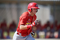 GCL Cardinals shortstop Mateo Gil (16) runs to first base during a game against the GCL Nationals on August 5, 2018 at Roger Dean Chevrolet Stadium in Jupiter, Florida.  GCL Cardinals defeated GCL Nationals 17-7.  (Mike Janes/Four Seam Images)