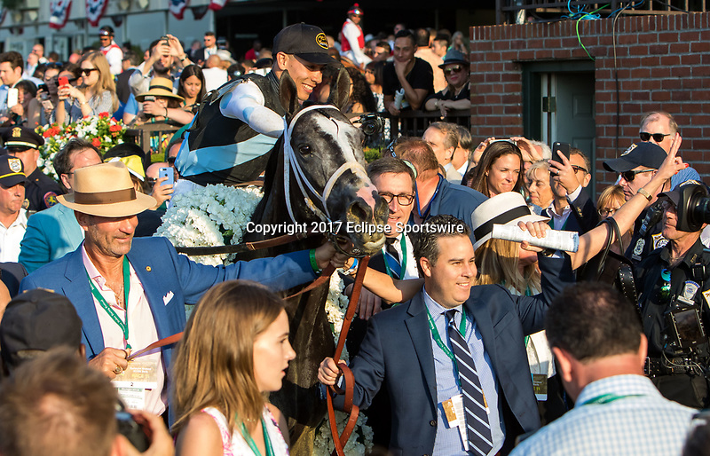 ELMONT, NY - JUNE 10: Tapwrit #2, ridden by Jose Ortiz, is led to the winner's circle after winning the 149th Belmont Stakes on Belmont Stakes Day at Belmont Park on June 10, 2017 in Elmont, New York (Photo by Sue Kawczynski/Eclipse Sportswire/Getty Images)