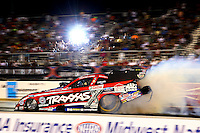 Sep 27, 2013; Madison, IL, USA; NHRA funny car driver Courtney Force does a burnout during qualifying for the Midwest Nationals at Gateway Motorsports Park. Mandatory Credit: Mark J. Rebilas-