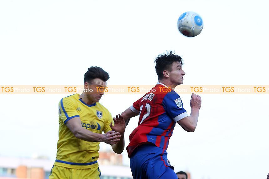 Oliver Hawkins of Dagenham and Jake Lawlor of Guiseley AFC during Dagenham & Redbridge vs Guiseley, Vanarama National League Football at the Chigwell Construction Stadium on 18th February 2017