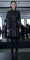 "Catherine Malandrino Fall/Winter 2013, LE NORMANDIE, XUCHAO: BLACK LEATHER ""STREAMLINE"" QUILTED JACKET/BLACK BOX PLEAT SKIRT WITH BLACK VELVET BORDER"