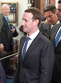 Surrounded by staff and security, Mark Zuckerberg, Co-Founder and Chief Executive Officer of Facebook, walks out of United States Senator Dianne Feinstein's (Democrat of California) office as he makes the rounds on Capitol Hill prior to giving testimony before Congress on Tuesday and Wednesday on Monday, April 9, 2018<br /> Credit: Ron Sachs / CNP<br /> (RESTRICTION: NO New York or New Jersey Newspapers or newspapers within a 75 mile radius of New York City)