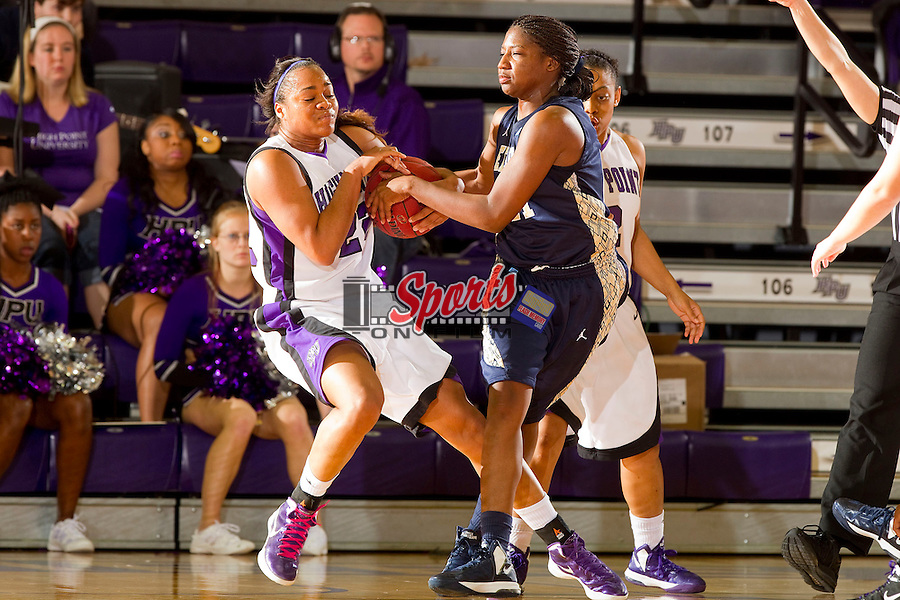 Jazmin Cromartie (22) of the High Point Panthers ties up the ball with Destiny Mitchell (41) of the East Tennessee State Buccaneers at Millis Athletic Center on November 10, 2012 in High Point, North Carolina.  The Panthers defeated the Buccaneers 85-76.   (Brian Westerholt/Sports On Film)