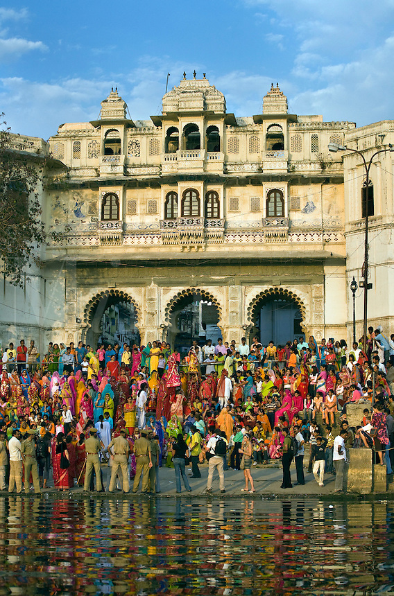 Rajasthani women gather at the GANGAUR GHAT on the shore of PICHOLA LAKE for the GANGAUR FESTIVAL or MEWAR FESTIVAL - UDAIPUR, RAJASTHAN, INDIA