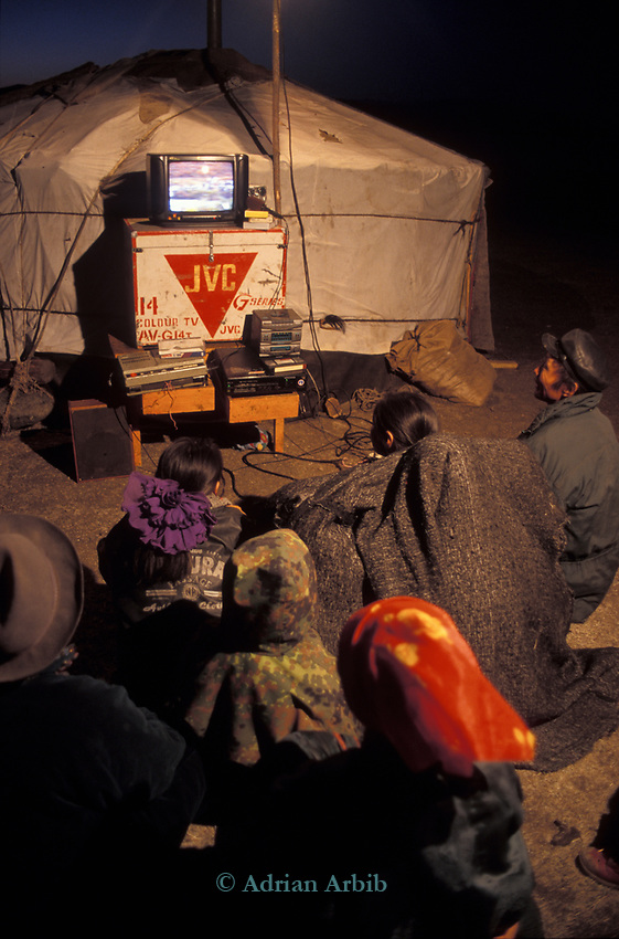 Tsaatan reindeer herders watching a video run from a motorbike,  Outer Mongolia.  Tsataan Uul.