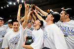 19 MAR 2011: University of St. Thomas (Minnesota) players celebrate after defeating the College of Wooster during the Division III Men's Basketball Championship held at the Salem Civic Center in Salem, VA. The University of St. Thomas (Minnesota) defeated College of Wooster 78-54 to win the national title.  Andres Alonso/NCAA Photos