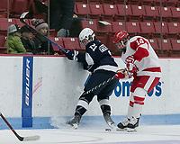 Boston, Massachusetts - December 31, 2018: NCAA Division I. Pennsylvania State University (Penn State) (blue) defeated Boston University (white), 1-0, at Walter Brown Arena.