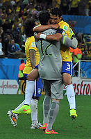SAO PAULO - BRASIL -12-06-2014. Thiago Silva y Julio Cesar guardameta  de Brasil celebran su victoria contra Croacia . Thiago Silva and goalkeeper Julio Cesar of Brazil celebrate their victory against CroatiaAccion de juego entre Brasil y Croacia  en partido del Grupo A de la fase inicial jugado en el estadio Arena Corinthians en Sao Paulo por la Copa Mundial de la FIFA Brasil 2014./Action game between Brazil and Croatia during the match of Group A of the initial phaseplayed at Arena Corinthians in Sao Paulo for the 2014 FIFA World Cup Brazil. Photo: VizzorImage / Alfredo Gutierrez / Contribuidor