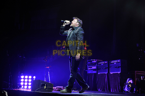 ELBOW - Guy Garvey.Performing live at the O2 Arena, London, England..March 28th, 2011.stage concert live gig performance music full length black suit singing side profile .CAP/MAR.© Martin Harris/Capital Pictures.
