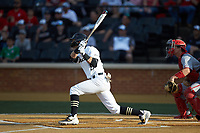 Patrick Frick (5) of the Wake Forest Demon Deacons follows through on his swing against the North Carolina State Wolfpack at David F. Couch Ballpark on April 18, 2019 in  Winston-Salem, North Carolina. The Demon Deacons defeated the Wolfpack 7-3. (Brian Westerholt/Four Seam Images)