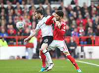 Nottingham Forest's Tobias Figueiredo battles with  Derby County's David Nugent<br /> <br /> Photographer Mick Walker/CameraSport<br /> <br /> The EFL Sky Bet Championship - Nottingham Forest v Derby County - Sunday 11th March 2018 - The City Ground - Nottingham<br /> <br /> World Copyright &copy; 2018 CameraSport. All rights reserved. 43 Linden Ave. Countesthorpe. Leicester. England. LE8 5PG - Tel: +44 (0) 116 277 4147 - admin@camerasport.com - www.camerasport.com