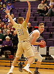 SIOUX FALLS, SD - NOVEMBER 25: Drew Guebert #23 from the University of Sioux Falls looks to make a move against 	Turner Moen #21 from Southwest Minnesota State University during their game Saturday night at the Stewart Center in Sioux Falls. (Photo by Dave Eggen/Inertia)