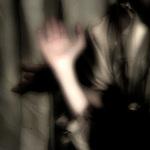 A blurred hand