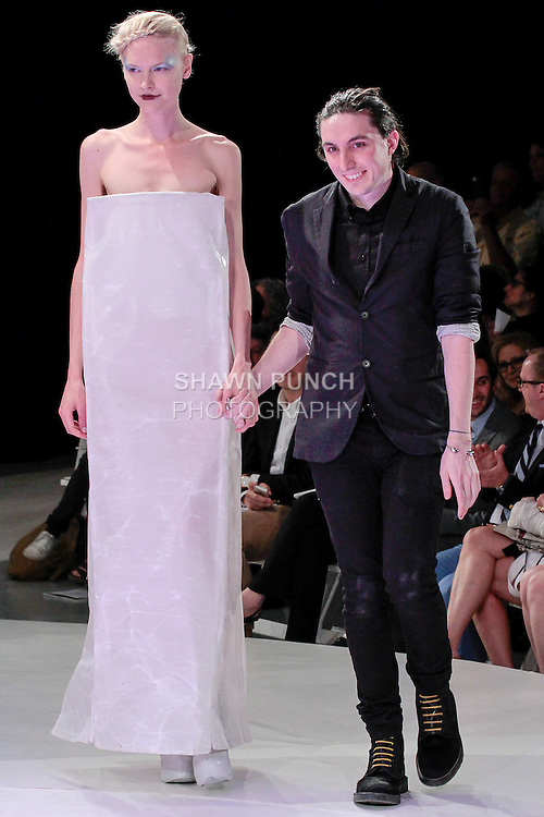Graduating fashion student Sam O'Brien, walks runway with model at the close of the 2013 Pratt Institute Fashion Show, on April 25, 2013.