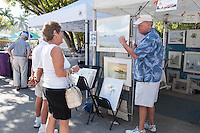 Artist Ron Berry chats with shoppers during Naples Art Association's annual Art in the Park at The von Liebig Art Center, Naples, Florida, USA, Dec. 1, 2012. Photo by Debi Pittman Wilkey