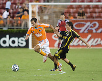 Houston Dynamo defender Patrick Ianni (4) steals the ball from Columbus Crew forward Guillermo Barros Schelotto (7). The Houston Dynamo tied the Columbus Crew 1-1 in a regular season MLS match at Robertson Stadium in Houston, TX on August 25, 2007.