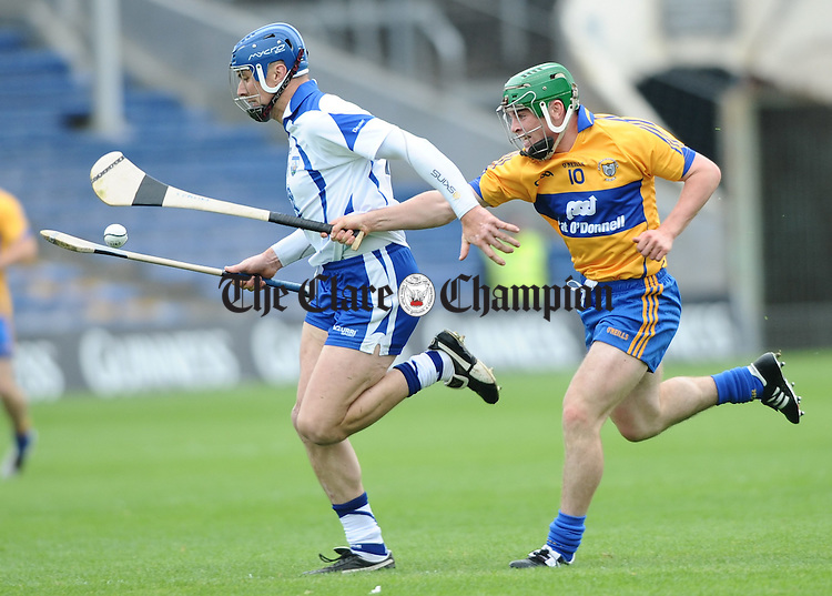Declan Prendergast of Waterford in action against Sean Collins of Clare during their Senior Munster Championship game in Thurles. Photograph by John Kelly.