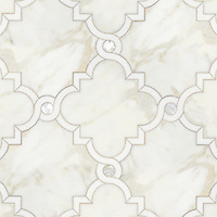 Atticus, a waterjet stone mosaic, shown in honed Calacatta, polished Thassos and Shell, is part of the Parterre Collection by Sara Baldwin for New Ravenna.