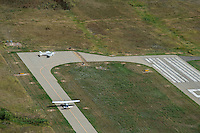 Small airplanes on taxiway at Erie, Colorado airport KEIK. Aug 20, 2014
