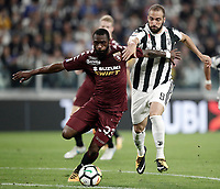 Calcio, Serie A: Torino, Allianz Stadium, 23 settembre 2017. <br /> Torino's Nicolas N'Koulou (l) in action with Juventus' Gonzalo Higuain (r) during the Italian Serie A football match between Juventus and Tori0i at Torino's Allianz Stadium, September 23, 2017.<br /> UPDATE IMAGES PRESS/Isabella Bonotto