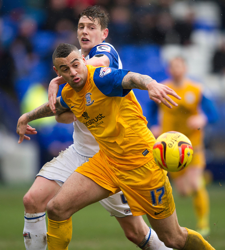 Preston North End's Craig Davies battles with Tranmere Rovers' Ash Taylor<br /> <br /> Photo by Stephen White/CameraSport<br /> <br /> Football - The Football League Sky Bet League One - Tranmere Rovers v Preston North End - Saturday 8th February 2014 - Prenton Park - Prenton<br /> <br /> &copy; CameraSport - 43 Linden Ave. Countesthorpe. Leicester. England. LE8 5PG - Tel: +44 (0) 116 277 4147 - admin@camerasport.com - www.camerasport.com