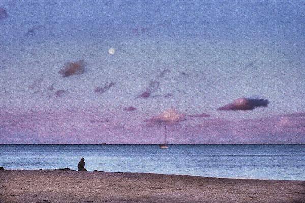 Lone figure on beach as dusk arrives.
