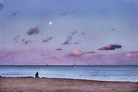 Lone figure on beach as dusk arrives.