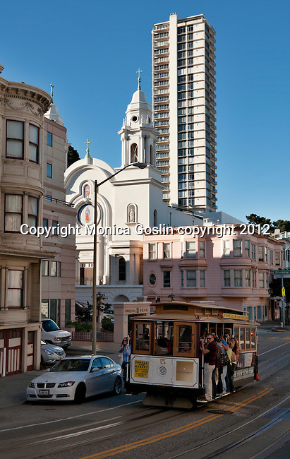 Cable car going down a hill on Mason Street  in San Francisco, California