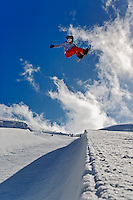 Snowboarder jumping in halfpipe, Klein Matterhorn, Zermatt, Switzerland, Model Released