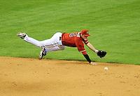 Apr. 14, 2009; Phoenix, AZ, USA; Arizona Diamondbacks shortstop Stephen Drew dives for a ground ball in the third inning against the St. Louis Cardinals at Chase Field. Mandatory Credit: Mark J. Rebilas-