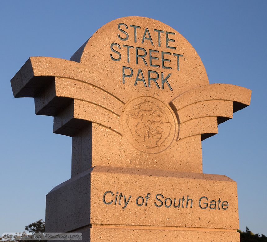 A closeup of the City of South Gate State Street Park sign in late afternoon light.