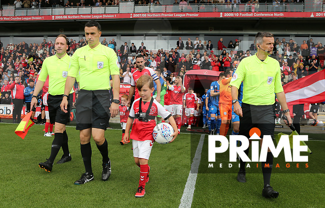 Fleetwood Town Match Ball Sponsors walks out ahead of the Sky Bet League 1 match between Fleetwood Town and Rochdale at Highbury Stadium, Fleetwood, England on 18 August 2018. Photo by Stephen Gaunt / PRiME Media Images.