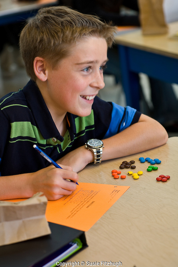 "Shamar Botley's seventh grade math class works with M&Ms to understand how one arrives at ""mean"" numbers."