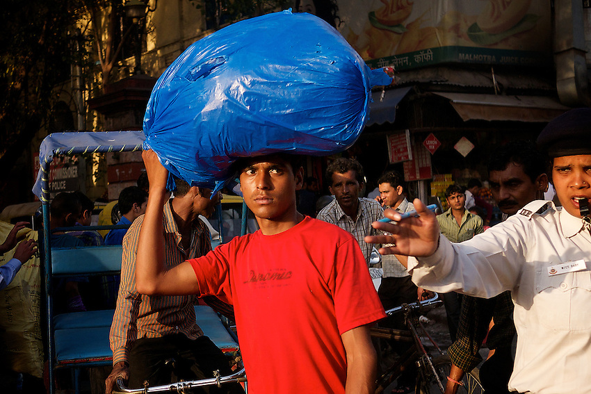 Daily life and the hustle and bustle at Khari Baoli a street in Old Delhi, known for its wholesale grocery and Asia's largest wholesale spice market selling all kinds of spices, nuts, herbs and just about everything else.