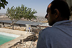 A swimming pool overlooking the Palestinian town of Artas near Bethlehem on 02/06/2010. The pool is located close to the future site of Israel's controversial West Bank barrier & there is a demolition order from the Israeli Civil Administration Pending against it & the adjacent house.