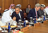 United States President Barack Obama talks to Sheikh Mohammed Al Khalid M Al Sabah of Kuwait while Secretary of State John Kerry talks to Sheikh Tameem Bin Hamad Al-Thani, Amir of the State of Qatar during a working lunch at the Gulf Cooperation Council-U.S. summit at Camp David, the Presidential Retreat near Thurmont, Maryland, on May 14, 2015. Obama hosted leaders from Saudi Arabia, Kuwait, Bahrain, Qatar, the United Arab Emirates and Oman to discuss a range of issues including the Iran nuclear deal. <br /> Credit: Kevin Dietsch / Pool via CNP