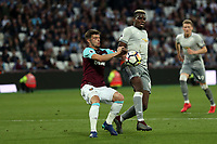 Paul Pogba of Manchester United is pulled up for hand ball whilst challenged by Aaron Cresswell of West Ham United during West Ham United vs Manchester United, Premier League Football at The London Stadium on 10th May 2018