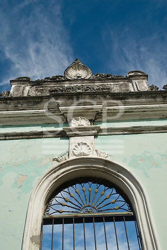 Ilheus, Bahia State, Brazil. Colonial style window in green painted wall.