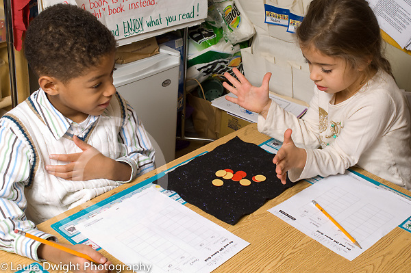 Education elementary school  Grade 1 boy and girl doing math activity
