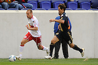 Joel Lindpere (20) of the New York Red Bulls is chased by Stefani Miglioranzi (6) of the Philadelphia Union. The New York Red Bulls defeated the Philadelphia Union 2-1 during a Major League Soccer (MLS) match at Red Bull Arena in Harrison, NJ, on April 24, 2010.