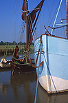 AT5BR3 Sailing barge and boat moored quayside Snape maltings Suffolk England