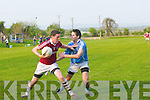 Tommy Curran (Dromid) keeps Ian Crowley (firies at bay in the junior championship in Farranfore on Saturday.....