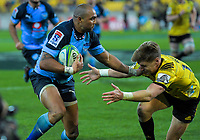 Bulls Cornal Hendricks hands off Hurricanes' Jordie Barrett during the Super Rugby quarterfinal between the Hurricanes and Bulls at Westpac Stadium in Wellington, New Zealand on Saturday, 22 June 2019. Photo: Dave Lintott / lintottphoto.co.nz