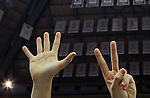 A Bishop McGuinness fan holds up 7 fingers, celebrating a  7th-consecutive state title, a new state record, at the Dean Smith Center in Chapel Hill, NC, on Saturday, March 10, 2012.  Photo by Ted Richardson