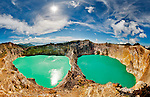 Panoramic view of the Kelimutu Lakes, in Flores, Indonesia. The volcanic lakes are colored by minerals. The lake on the right changes from turquoise to red to brown and back again over the course of several months.