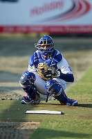 Burlington Royals catcher Nathan Esposito (7) warms up his starting pitcher in the bullpen prior to the game against the Princeton Rays at Burlington Athletic Stadium on June 24, 2016 in Burlington, North Carolina.  The Rays defeated the Royals 16-2.  (Brian Westerholt/Four Seam Images)